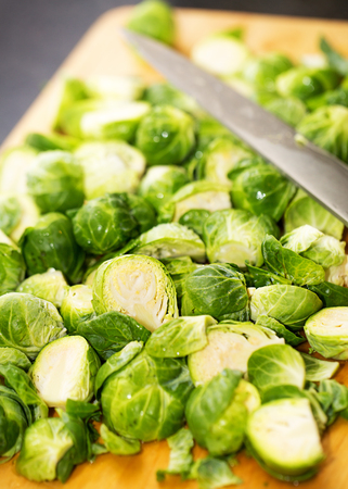 brussel: Bunch of fresh green brussel sprouts on a wood cutting board