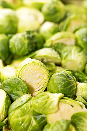 brussel: Closeup of a bunch of fresh raw brussel sprouts cut up and ready to cook.
