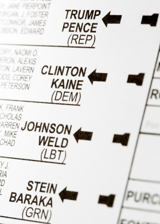 absentee: PHOENIX, AZ - OCTOBER 21, 2016: Close up of the presidential candidates on the 2016 USA general election early voting ballot including Donald Trump, Hillary Clinton, Gary Johnson and Jill Stein
