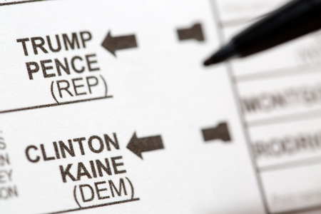 absentee: PHOENIX, AZ - OCTOBER 21, 2016: Close up of a pen about to mark the 2016 USA general election early voting ballot form where voters are able to choose from presidential candidates including Donald Trump and Hillary Clinton.