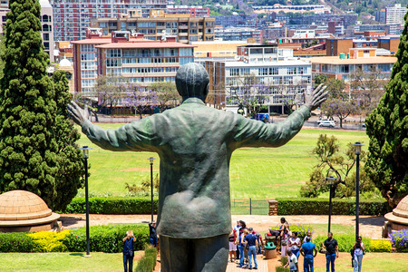apartheid in south africa: PRETORIA, SOUTH AFRICA, November 4, 2016.  A large statue of former South African president Nelson Mandela stands 9 meters tall in the middle of the Union Buildings in Pretoria