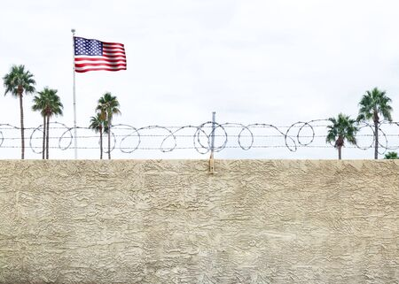 national border: Wall with secure barbed wire fence along the southern border of the United States Stock Photo