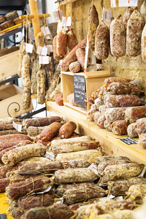 Volterra, Italy - May 18, 2017: Salami on sale display in a tourist meat shop in Volterra Italy Editorial