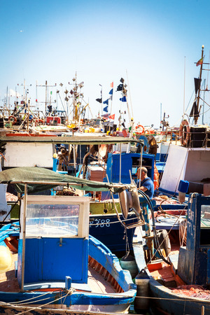 Trapani, Sicily, Italy - May 20, 2017: Fisherman on boat in harbor of Trapani, Sicily. Tuna fishing is the main industry in this area during May and June.