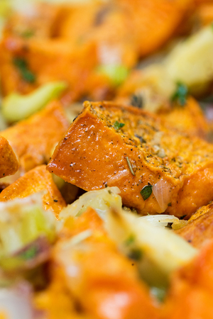 Healthy vegetable side dish of roasted sweet potatoes, bacon, apple, celery, onion and herbs Stok Fotoğraf