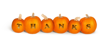Row of six Thanksgiving holiday pumpkins carved to say Thanks and illuminated inside with candles. Isolated on white and sized for a popular social media cover image.