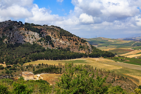 Beautiful view from the hilltop town of Segesta in Sicily Italy overlooking valley and ancient stone temple ruins