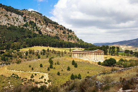 Beautiful view from the hilltop town of Segesta in Sicily Italy overlooking ancient ruins of a stone temple