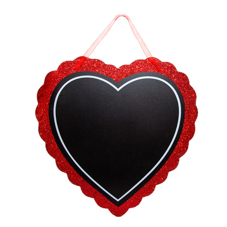 Heart-shaped blank chalkboard to enter Valentines day message, with red ribbon to hang up Stock Photo