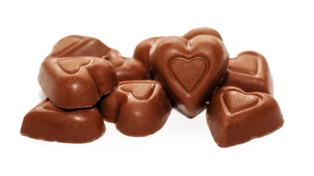 Pile of heart shaped gourmet chocolate Valentine's Day candy Archivio Fotografico