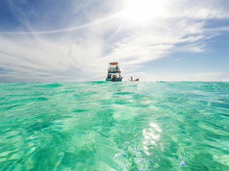 Fishing and fun party boat in the clear turquoise blue Caribbean Sea with copy space Stockfoto