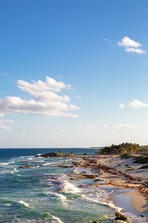 Waves on shore of Caribbean Sea in Cozumel Mexico. Overhead view in vertical orientation with copy space in sky. Stock Photo