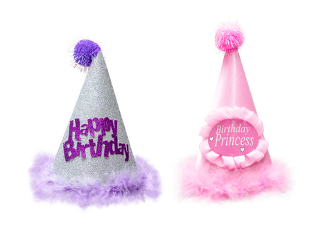 Two fancy pretty birthday party hats for a little girl. Isolated on white.
