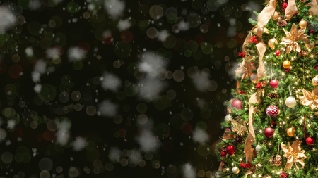 Closeup of half of Christmas tree with falling snow. Stock Photo