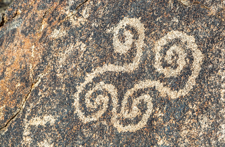 Spiral petroglyph drawing carved in rocks by ancient Hohokam indians in Phoenix, Arizona