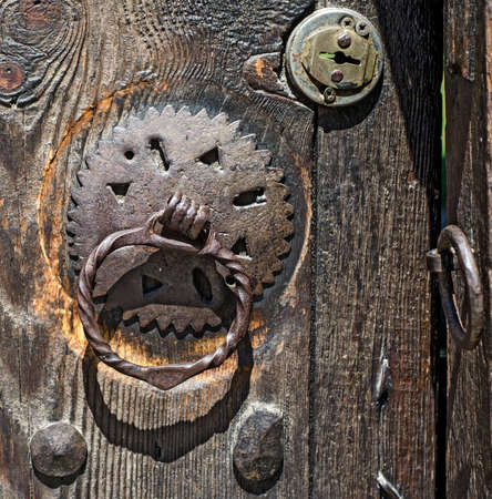Door knockers and locks on old gates in Koprivshtica town, Bulgaria Stock Photo
