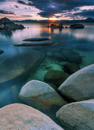 The northern part of Lake Tahoe straddles the border between Calfiornia and Nevada. Its dominant features are big glaciated boulders and clear blue waters.