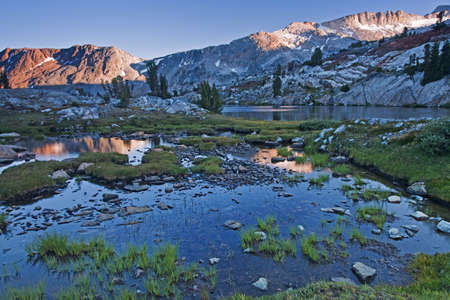 sierras: The Sierra Nevada is a mountain range in the Western United States, between the Central ... The Sierra Nevada lies in Central and Eastern California, with a very small but historically important spur extending into Nevada. Stock Photo
