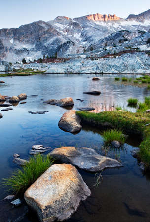 high sierra: The Sierra Nevada is a mountain range in the Western United States, between the Central ... The Sierra Nevada lies in Central and Eastern California, with a very small but historically important spur extending into Nevada. Stock Photo