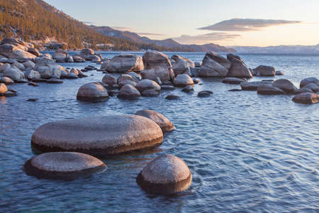 rock formation: Lake Tahoe is a large freshwater lake in the Sierra Nevada of the United States. Stock Photo
