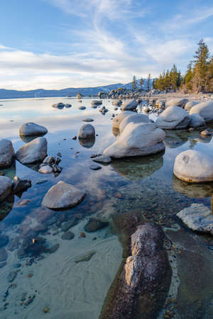 Lake Tahoe is a large freshwater lake in the Sierra Nevada of the United States. Stock Photo