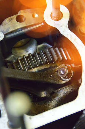 closeup photo of motorcycle gearbox with metal gear
