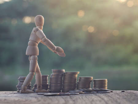 dummy: wooden dummy doll with coins  background