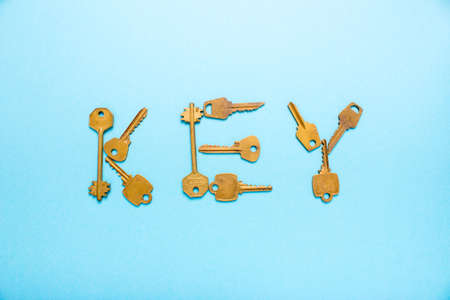 Key word is written inlaid keys on a blue background Stock Photo