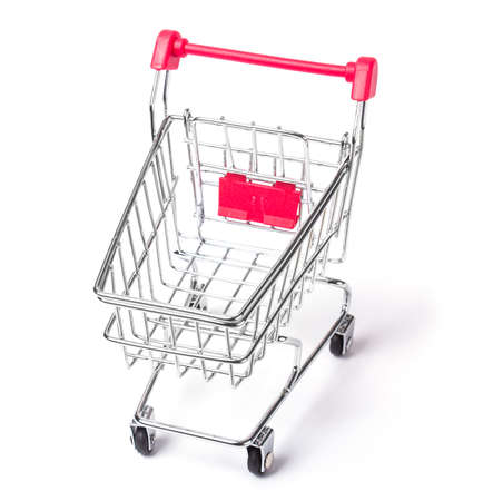 empty shopping cart: Empty shopping cart with the red handle on a white isolated background Stock Photo