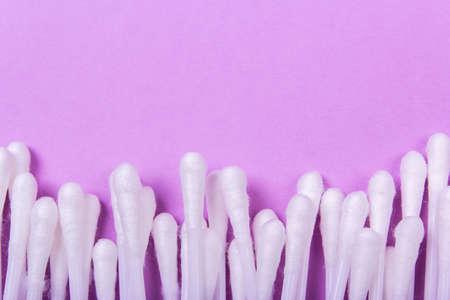 closeup clean ear sticks on violet background slide Stock Photo