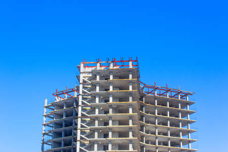 construction of a building on a background of blue sky