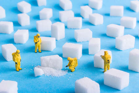 The team investigates the sugar cubes on a blue background Banco de Imagens - 73923383