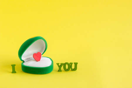 diamond letters: green box for jewelry with a heart inside and words I love you on a yellow background