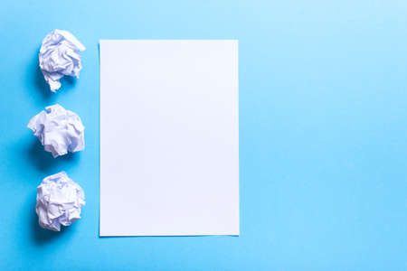 b ball: Crumpled paper ball and clean sheet on a blue background Stock Photo