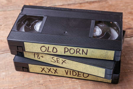 Old videocassettes VHS with films. XXX movies for adults