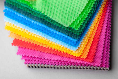 Samples of colored fabric for buyers choice. Example fabric Stock Photo