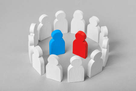 Concept leader of  business team. Crowd of white men stands in  circle and listens to the blue and red speaker candidate, work with objections, conflict