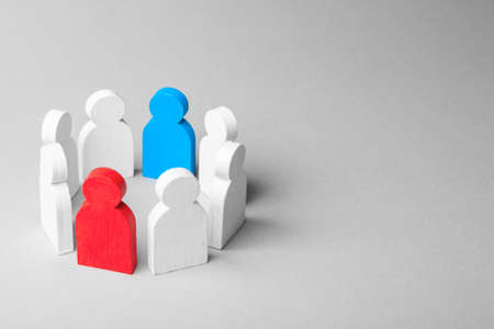 Concept leader of a business team. Crowd of white men stands in circle and listens to leader of blue and red man, work with objections, conflict Stock Photo