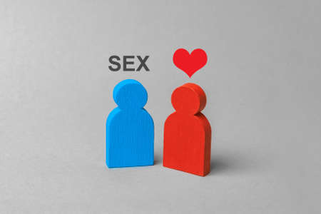 Love for sex, prostitution, intimate services. Man wants sex and  woman with  heart. Concept Stock Photo