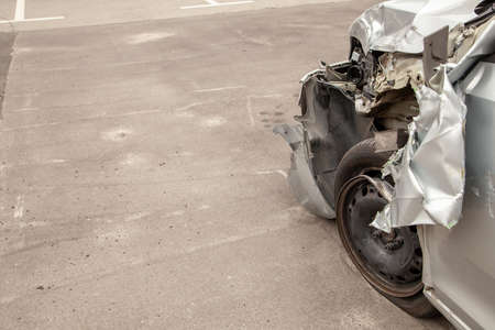Crash car in front after the accident. Broken wing and wheel, bumper and undercarriage. Copy space for text