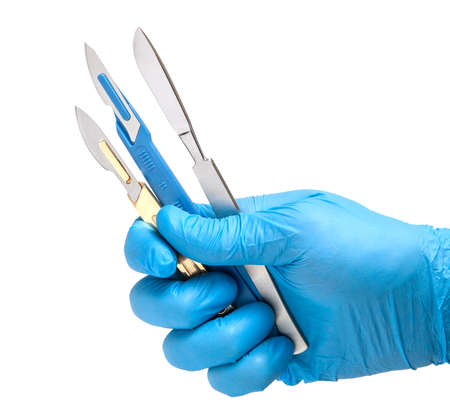 Scalpel in the hands of doctor in gloves isolated on white background. Surgeon with knife before surgery
