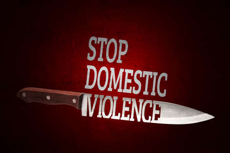 Stop domestic violence. Kitchen knife on red shabby background.