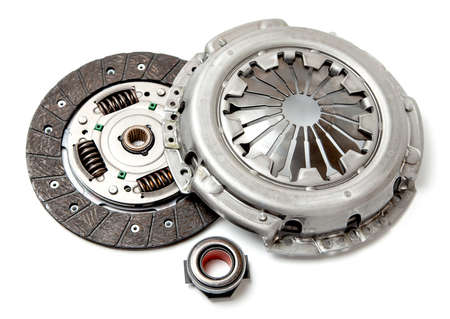 Set of replacement automotive clutch isolated on white background. Disc and clutch basket with release bearing
