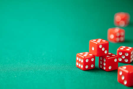 Red dices on green poker gaming table in casino. Concept online gambling. Copy space for text Stock Photo