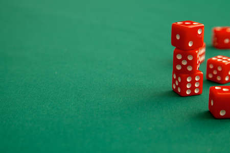 Red dices on green poker gaming table in casino. Concept online gambling. Copy space for text. Stock Photo
