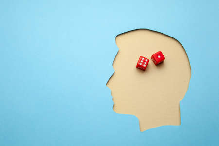 Game addiction or addict. Human head profile with gaming dice. Copy space for text