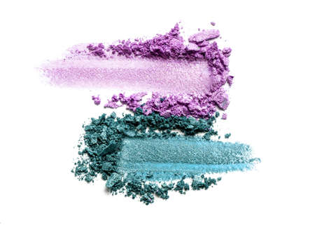Eye shadow on a white background. Scattered blush sample for makeup. Purple and Mint color