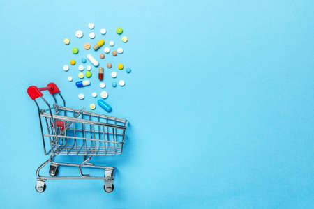 Shopping basket and pills. The concept of buying drugs online, delivery of medical devices. Copy space for text