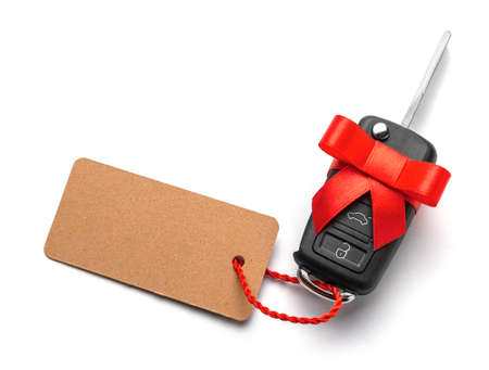Gift Car keys with remote control alarm with red ribbon with bow and label. Isolated On White Background