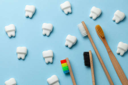 Healthy white teeth on pink background with toothbrush. Stok Fotoğraf